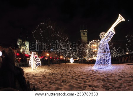 Night light in Prague. Light angel on the Christmas market. Czech Republic. - stock photo