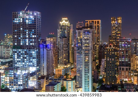 Night light of Bangkok. Panoramic and perspective view light blue background of glass high rise building skyscraper commercial of future. Business concept of success industry tech architecture - stock photo