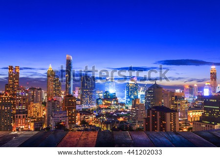 night light of Bangkok wooden floor. Panoramic and perspective view background of glass high rise building skyscraper commercial of future. Business concept of success industry tech architecture - stock photo
