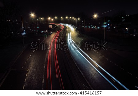 Night lights of cars captured on a long exposure. - stock photo