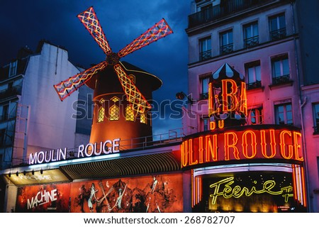 Night lights of the Moulin Rouge cabaret in Paris, France on August 6, 2012 - stock photo