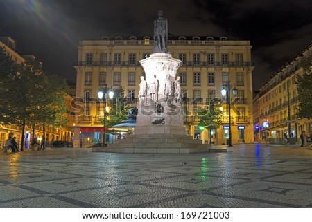 Night-lit fountain statue in Lisbon, Portugal - stock photo
