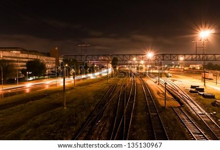 Night long exposure shot on railroad track - stock photo