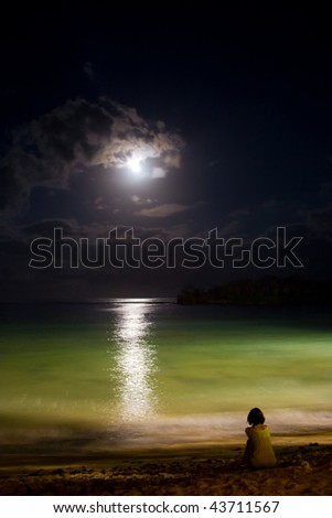 Night ocean with moon and moonlight reflection on water. Solitude. - stock photo