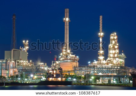 Night of Oil refinery plant along river in Bangkok - stock photo