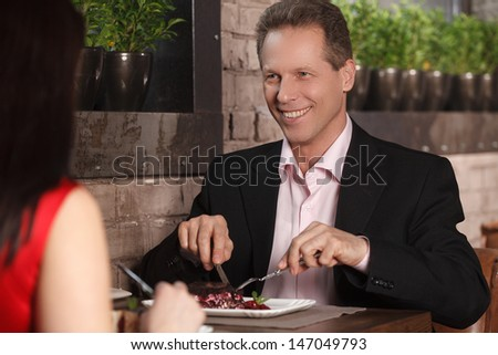 Night out at the restaurant. Mature couple having dinner at the restaurant - stock photo