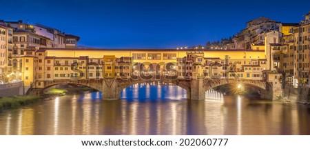 Night panoramic view of Vecchio Bridge (Ponte Vecchio, Old bridge), Florence, Italy - stock photo