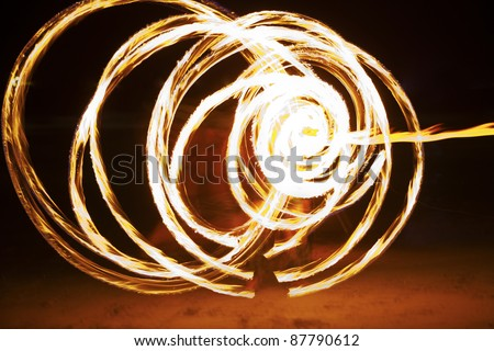 Night Party. Fire show on the beach - stock photo