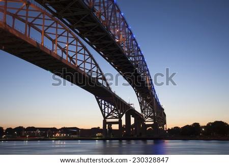 Night Photo Blue Water Bridge Ontario Michigan Sarnia Port Huron - stock photo