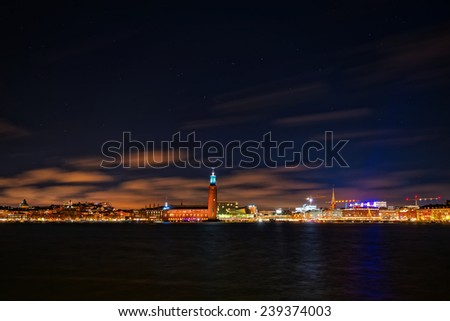 Night photography of the city center with the town hall in Stockholm, clear sky with stars, Sweden  - stock photo