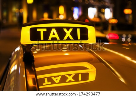 night picture of a taxi car - stock photo