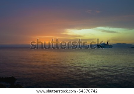 Night picture of cruise boat at dusk in Aegean sea, Mykonos, Greece - stock photo