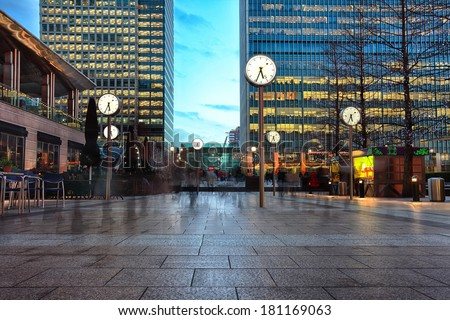 night picture of six public clock in Canary Wharf  - stock photo