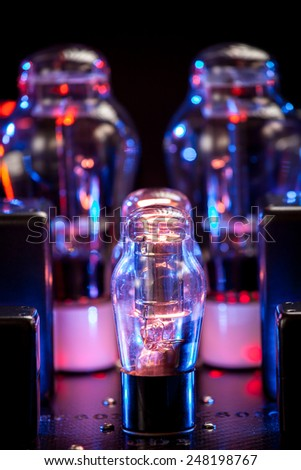 Night picture of thermionic tubes. Bokeh background - stock photo