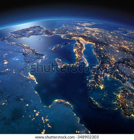 Night planet Earth with precise detailed relief and city lights illuminated by moonlight. Africa and Europe. The waters of the Mediterranean Sea. Elements of this image furnished by NASA - stock photo