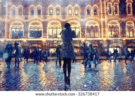 Night portrait of the girl in a winter city - stock photo