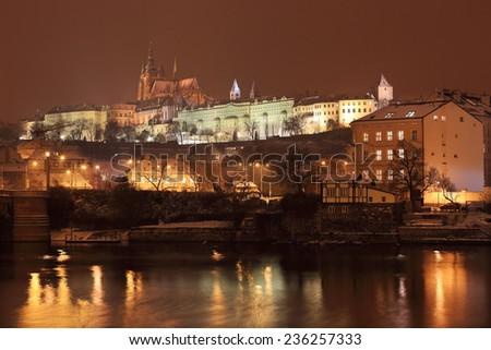 Night romantic snowy Prague gothic Castle above River Vltava, Czech republic - stock photo