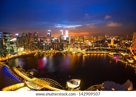Night scene of financial district Singapore from roof Marina Bay Hotel - stock photo
