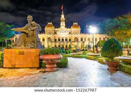 Night scene of Ho Chi Minh City Hall in Ho Chi Minh City, Vietnam. It was built in 1902-1908 in a French colonial style for the then city of Saigon. - stock photo