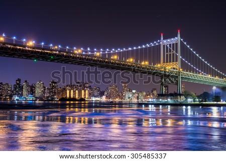 Night scene of New York City and the Queensboro Bridge  - stock photo
