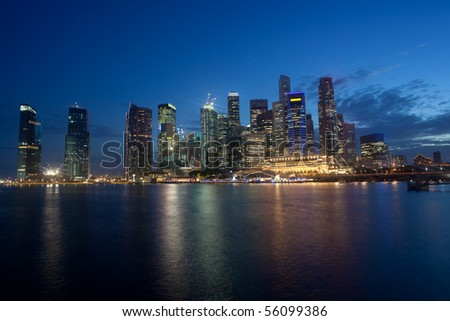 Night scene of Singapore Financial District skyline in the twilight hours - stock photo