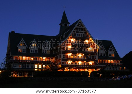 Night scene of the famous historic Prince of Wales Hotel in waterton lakes national park, alberta, canada - stock photo