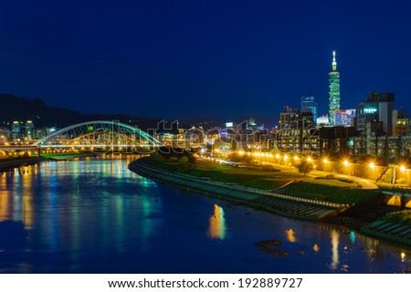 Night scenes of the Taipei city by the river - stock photo