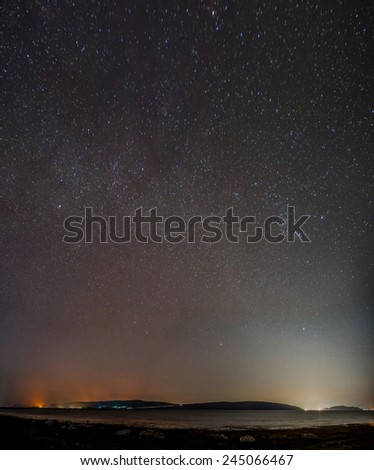 Night sky over the lake (contain noise and moved star) - stock photo