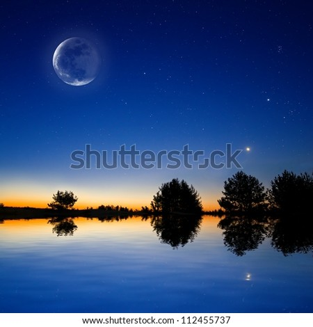 night sky scene reflected in a lake - stock photo