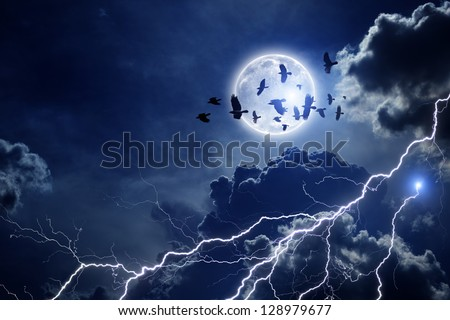 Night sky with full moon, lightning, dark clouds. Flock of flying ravens, crows in dark sky. Elements of this image furnished by NASA - stock photo