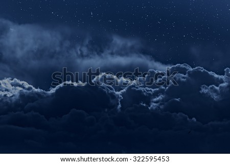 Night sky with stars and strong clouds as seen from above - stock photo