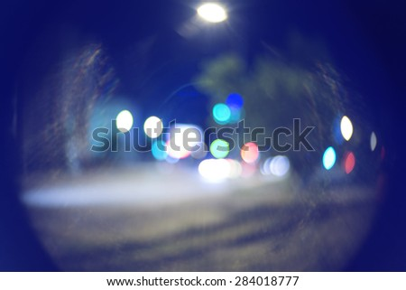 Night street bokeh defocused blurred background toned in blue - stock photo