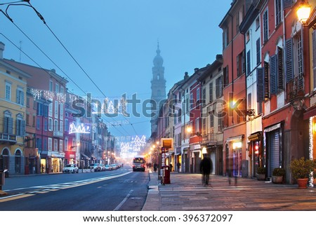 Night street lighted with lamps in Parma, Emilia Romagna region, Italy. - stock photo
