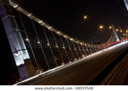 Night street lights in motion - stock photo