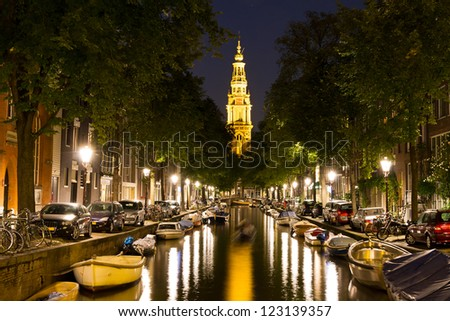 Night time Amsterdam, the Netherlands. View from the Groenburgwal towards the southern church (Zuiderkerk) - stock photo