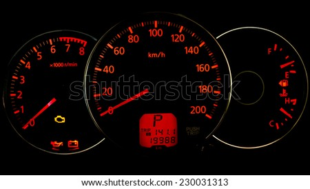 Night time close up of car dashboard - stock photo