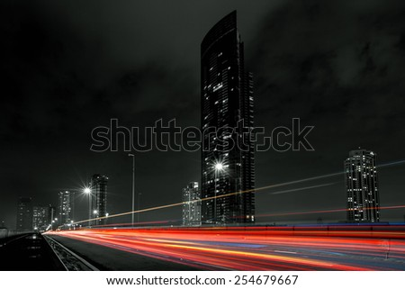 Night time traffic light in the city - stock photo