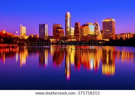 Night to Sunrise Downtown Austin Texas Reflections of City Lights - stock photo