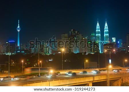 Night traffic in Kuala Lumpur. Skyline of KL on the background. Malaysia - stock photo