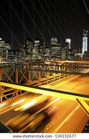 Night traffic in the brooklyn bridge with a skyline of New York - stock photo