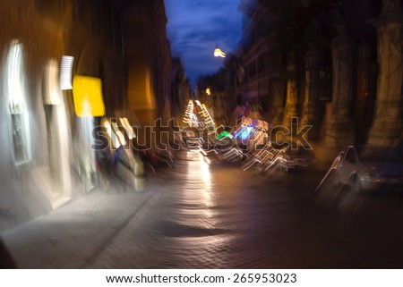 Night traffic in the old part of Rome city in Italy - stock photo