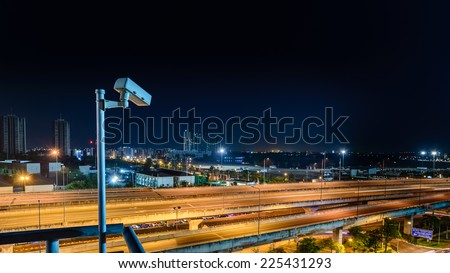 Night traffic monitoring  with CCTV. - stock photo