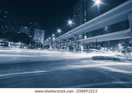 Night traffic of busy city road - stock photo