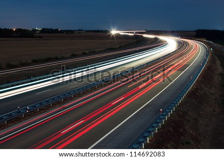 Night traffic on a highway - stock photo
