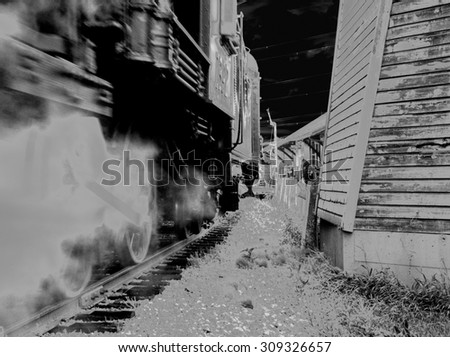 NIGHT TRAIN.  Steam locomotive with a full head of steam underway on the Canadian Prairies in black and white format - stock photo