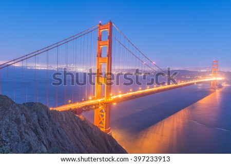 Night view at illuminated Golden Gate Bridge which spans Golden Gate strait at San Francisco Bay. California, USA - stock photo