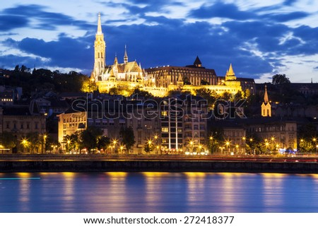 Night view from the Danube river of the Mathias Church - stock photo