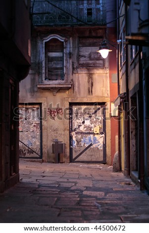 Night view of a messy alley of old Porto, Portugal - stock photo