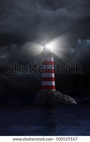Night view of a red and white old lighthouse - stock photo