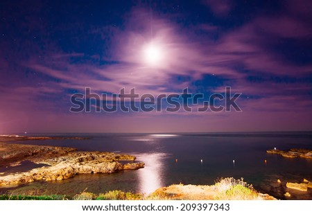 night view of Alghero rocky coastline - stock photo